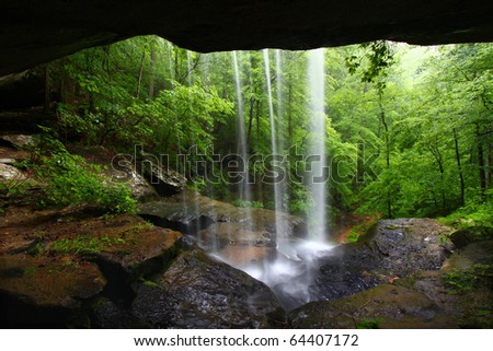 View from behind a tranquil waterfall on Cane Creek in northern Alabama - stock photo