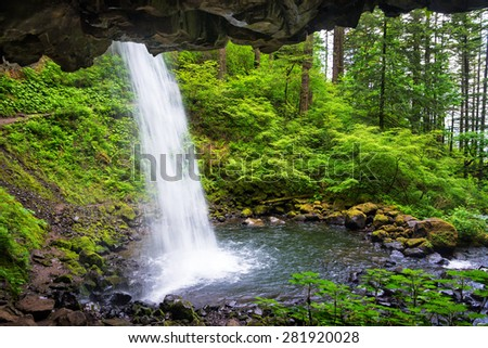 View from behind Horsetail Falls in the Columbia River Gorge in Oregon - stock photo