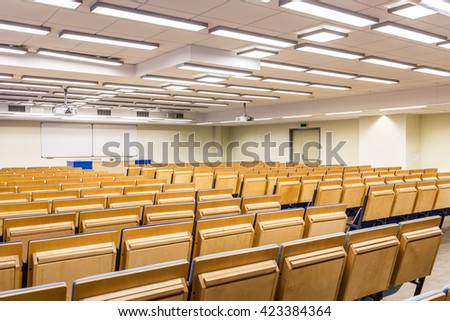 View from behind of a lecture hall towards whiteboard