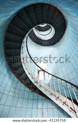 View from beneath of a spiral staircase (Charente Maritime / France) - stock photo