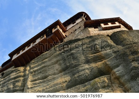 View from bottom on the Monastery Roussanov at sunrise, Meteora, Greece