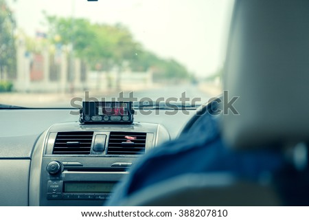 View from cab with meter display in Thailand. - stock photo