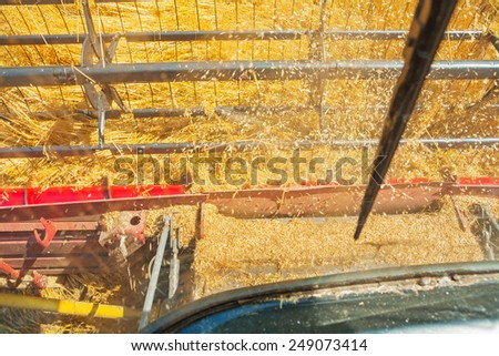 view from cabin of combine harvester in time of harvest  - stock photo