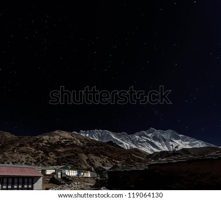 View from Chhukhung of Nuptse (7864 m) ang Lhotse (8516 m) in the Moonlight - Everest region, Nepal, Himalayas - stock photo