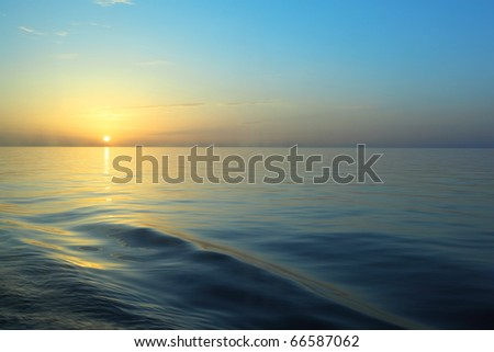 view from deck of cruise ship. beautiful sunrise under water. - stock photo