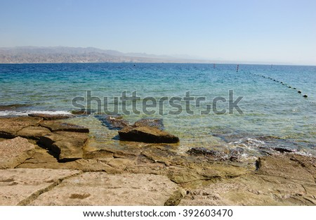 View from Eilat's Coral Beach towards Aqaba in Jordan (Eilat. Israe). Coral Beach Nature Reserve in Eilat, one of the most beautiful coral reef in the world, is famous tourist and diver attraction.