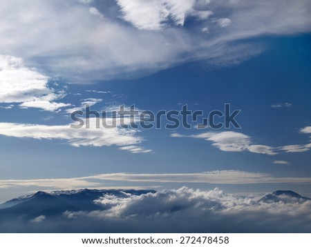 View from height on far mountains under clouds. - stock photo