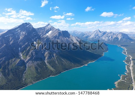 view from helicopter at beautiful mountains and river in jasper national park, alberta, canada - stock photo