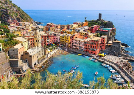 View from high hill of Vernazza houses and blue sea, Cinque Terre national park, Liguria, Italy