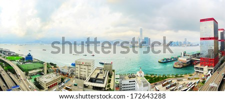 View from Hong Kong to Kowloon island. Ferry piers on right side of picture.  - stock photo