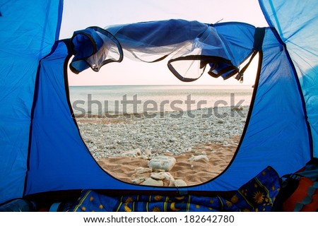 View from inside a tent on sea - stock photo