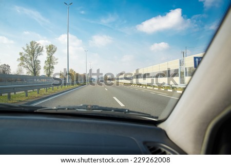 view from inside the car on the road - stock photo