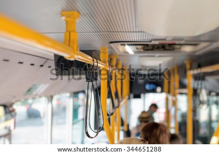 View from inside the city bus with passengers. - stock photo