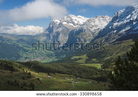 View from Kleine Scheidegg at Grindelwald (Berner Oberland, Switzerland). The Kleine Scheidegg is a mountain pass (2,061 metre), below and between the Eiger and Laubhorn in the Bernese Oberland. - stock photo