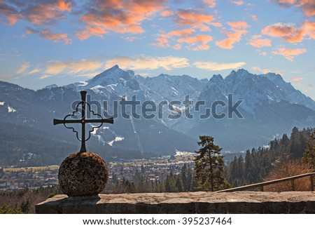 view from kramer mountain memorial to zugspitze mass, bavarian sunset landscape - stock photo