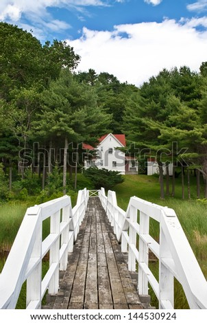 View from lighthouse bridge to keeper's house at Doubling Point on Kennebec River, Maine, coastal New England. - stock photo
