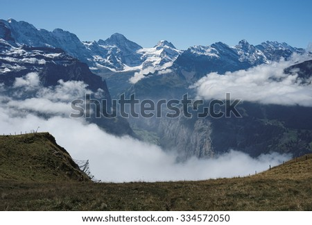View from Mannlichen at the Bernese Alps (Berner Oberland, Switzerland). The Mannlichen is a mountain (2,343 metre) in the Swiss Alps located within the Canton of Bern. - stock photo