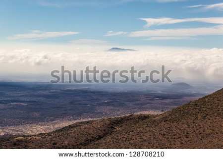 View from Mauna Kea mountain with visible Maui Island in distance. Mauna Kea, Big Island, Hawaii - stock photo
