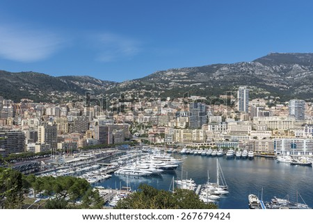 View from Monaco Ville across Port Hercule towards Monte Carlo on a sunny day. - stock photo