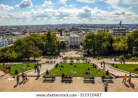 View from Montmartre to summer Paris and beautiful blue sky with soft clouds.