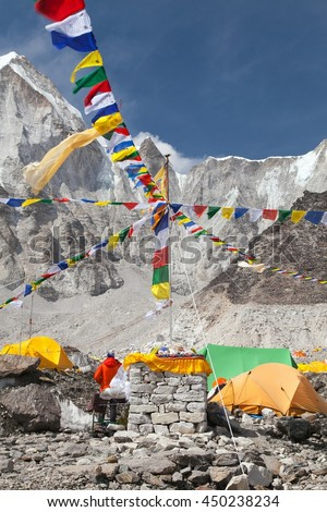 View from Mount Everest base camp, tents and prayer flags, sagarmatha national park, trek to Everest base camp - Nepal - stock photo