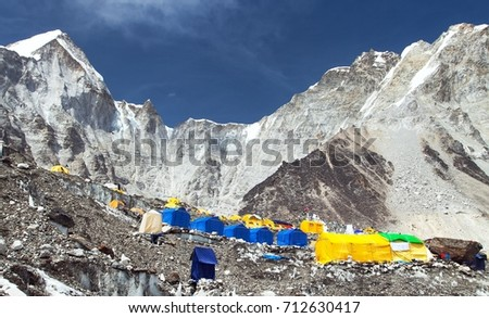 view from Mount Everest base camp with blue and yellow tents - Khumbu valley - Nepal
