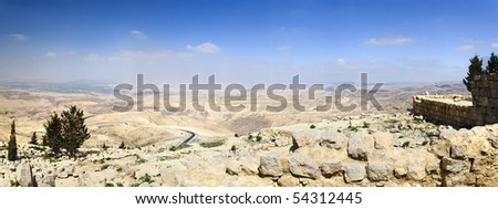 View from Mount Nebo, place of Moses grave, to the valley. Panoramic shot. - stock photo