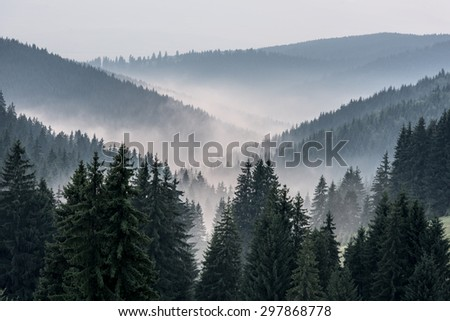 View From Mountains to the Valley Covered with Foggy. Foggy Landscape. - stock photo