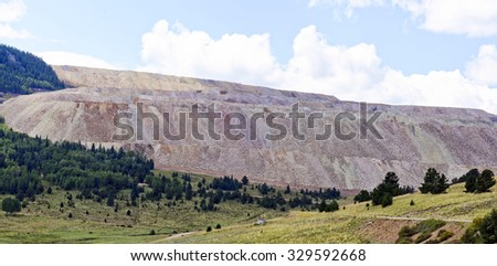 View from near Cripple Creek, Colorado, U,S.A. of the active Cripple Creek and Victor Mining District open cast gold mine - stock photo