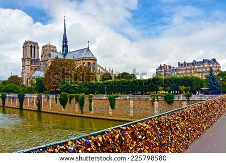 View from Notre Dame de Paris, Seine River and Pont des Arts (Passarelle des Arts) with many locks symbolize love for ever. - stock photo