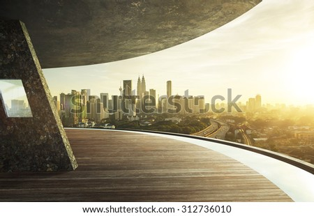 View from open space balcony, Kuala Lumpur city centre during sunset. - stock photo