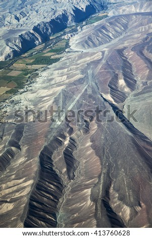 view from plane on the geoglyphs plateau Nazca