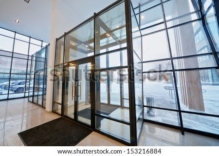 View from reception hall of office building at inner yard - stock photo