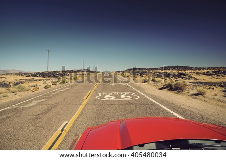 view from red car on famous Route 66 in Californian desert, USA, Vintage filtered style