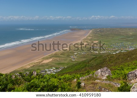 View from Rhossili Down to Burry Holms and Hillend The Gower peninsula Wales UK in summer with caravans and camping on the campsite