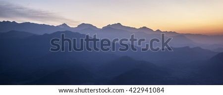 View from Sarangkot viewing point on Annapurna range in fog during dawn. Sarangkot is located 1592m or 5500ft above see level and is the highest viewing point in Pokhara area.