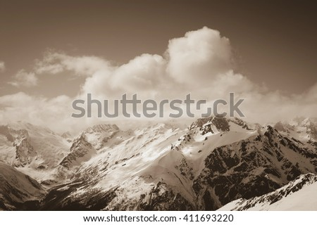 View from ski slope on snowy mountains. Mountains, Caucasus, region Dombay. Toned landscape.
