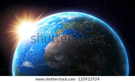 View from space of the Sun setting over Earth - stock photo