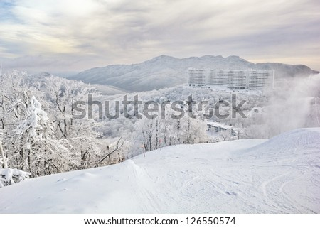View from Sugar Mt., NC as the storm leaves, the fog lifts, ice crystals hang in the air and frost coats the world. - stock photo