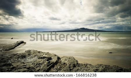View from Takapuna beach to Rangitoto Island - stock photo