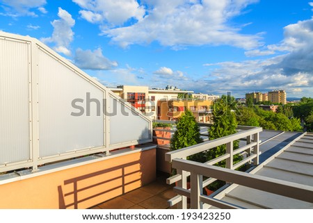 View from terrace of new city apartment with beautiful clouds on blue sky, Krakow, Poland