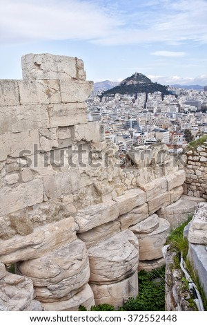 View from the Acropolis to the Athens suburb. On the background could see mount Lycabettus. Greece.