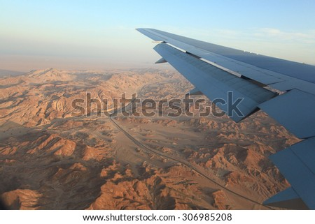 view from the airplane desert mountains - stock photo