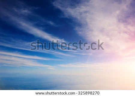 View from the airplane of a beautiful fluffy big clouds with sunlight background with copy space for your text message or promotional content, advertise field - stock photo