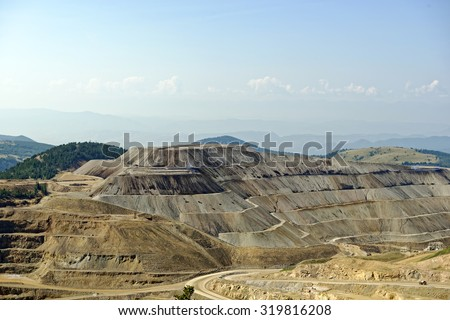 View from the American Eagles Overlook near Victor, Colorado, U.S.A. of the Cripple Creek mining district open cast gold mine - stock photo