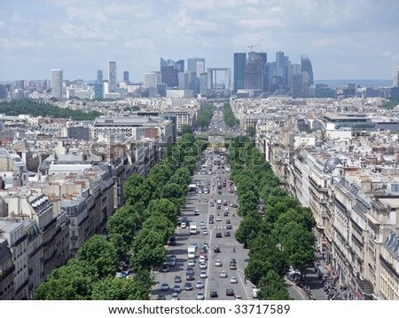 view from the Arc de Triumph across Paris roof tops towards the La Défense