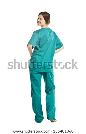 view from the back. Doctor in the form. studio white background - stock photo