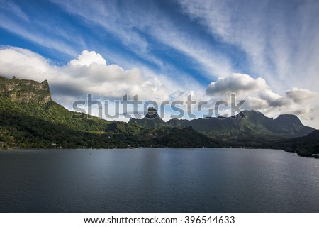 View from the bay to the island of Moorea, French Polynesia against cloudy sky in summer