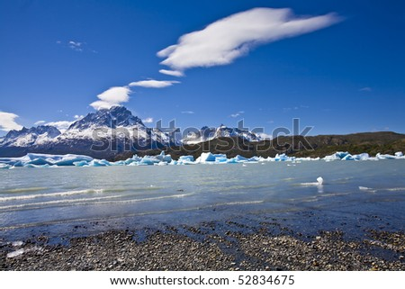 view from the beach of lake grey in torres del paine national park, chile - stock photo