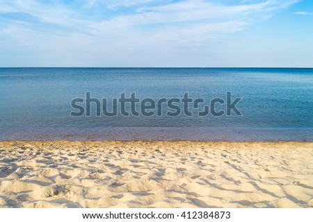 View from the beach on the wide calm sea, Beach walk in the early morning, Wide horizon; Coastal landscape